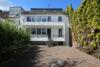 Kernsanierte 3-Zi.-Wohnung mit Balkon und ca. 73 m² großer Terrasse - Rückansicht